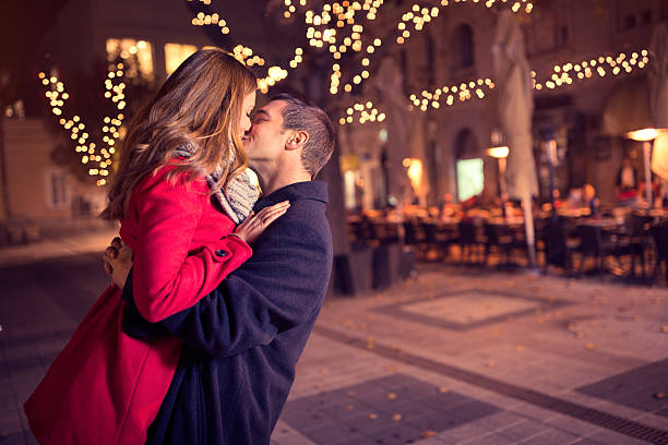Young affectionate couple kissing tenderly stock photo