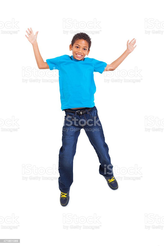 young african american boy jumping stock photo