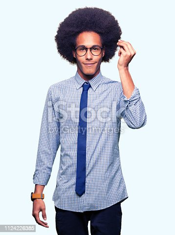 istock Young african american business man with afro hair wearing glasses Doing Italian gesture with hand and fingers confident expression 1124226385