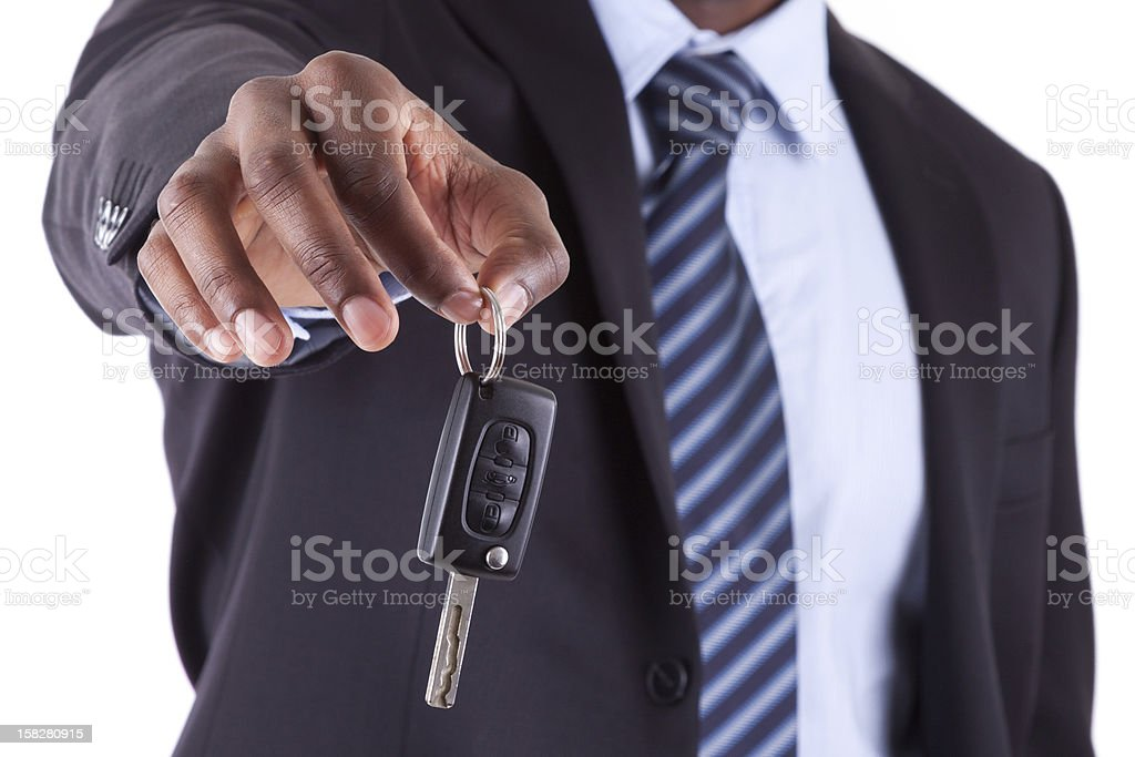 Young African American businessman holding a car key stock photo