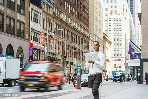 istock Young African American businessman traveling, working in New York 1139279021