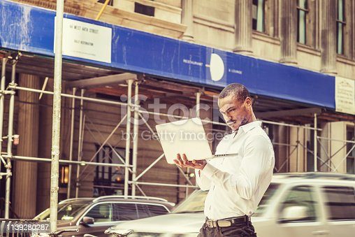 istock Young African American businessman traveling, working in New York 1139280287