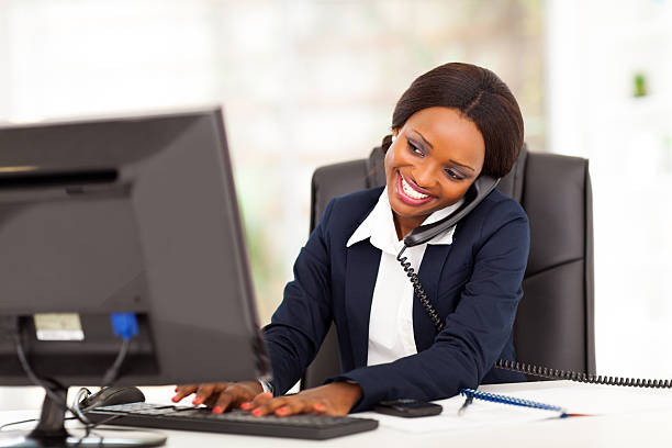 young african american businesswoman working stock photo