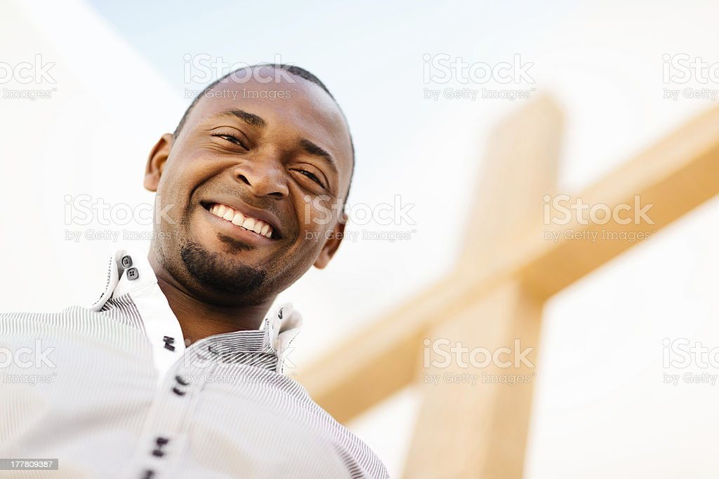 Young african american christian man with cross stock photo