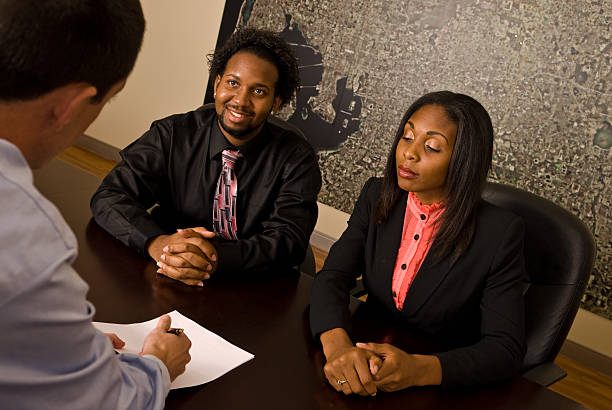 Young African American couple about to sign papers stock photo