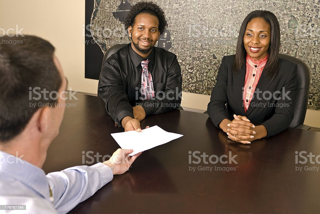Young African American couple about to sign papers royalty-free stock photo