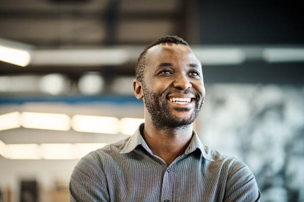 Young African American designer dreaming up new ideas for business stock photo