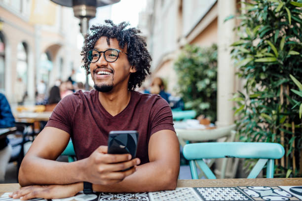 Young African American enjoying his free time outdoors stock photo