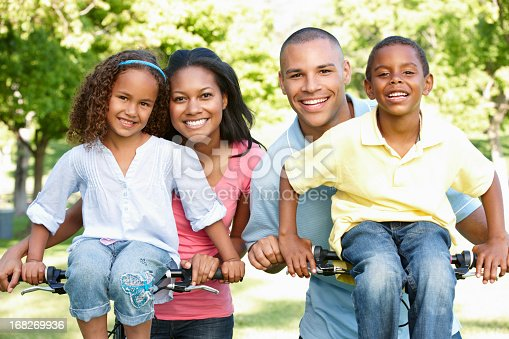 istock Young African American Family Cycling In Park 168269936