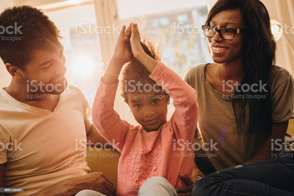 Young African American family enjoying in time together at home. - Royalty-free Adult Stock Photo
