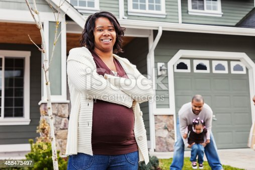 istock Young African American Family of Three at Home 488473497