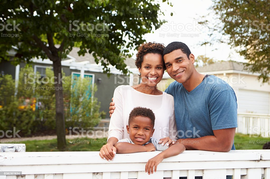 Young African American family outside their new house stock photo