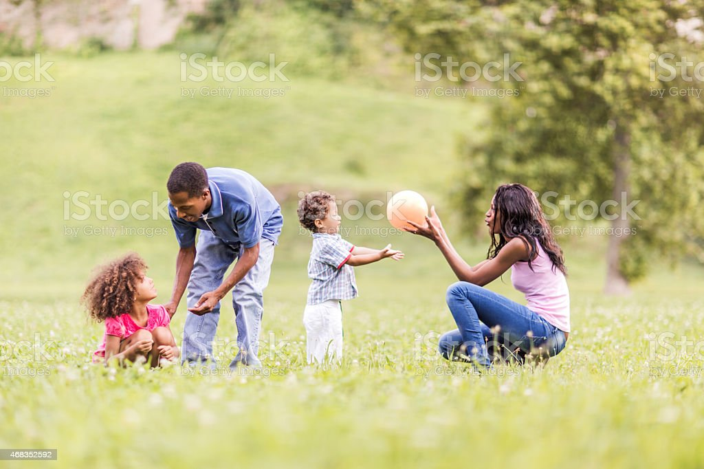 A young African American family playing with their kids royalty-free stock photo