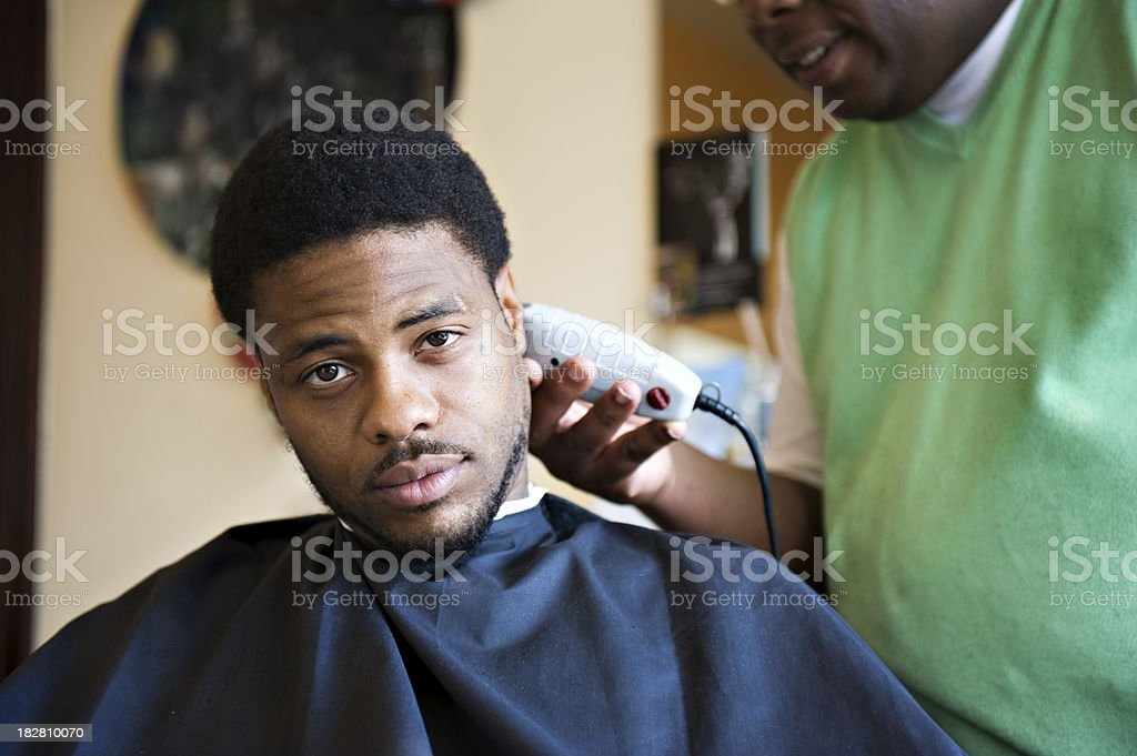 Young African American Gets Haircut And Shave At Barber Shop Stock