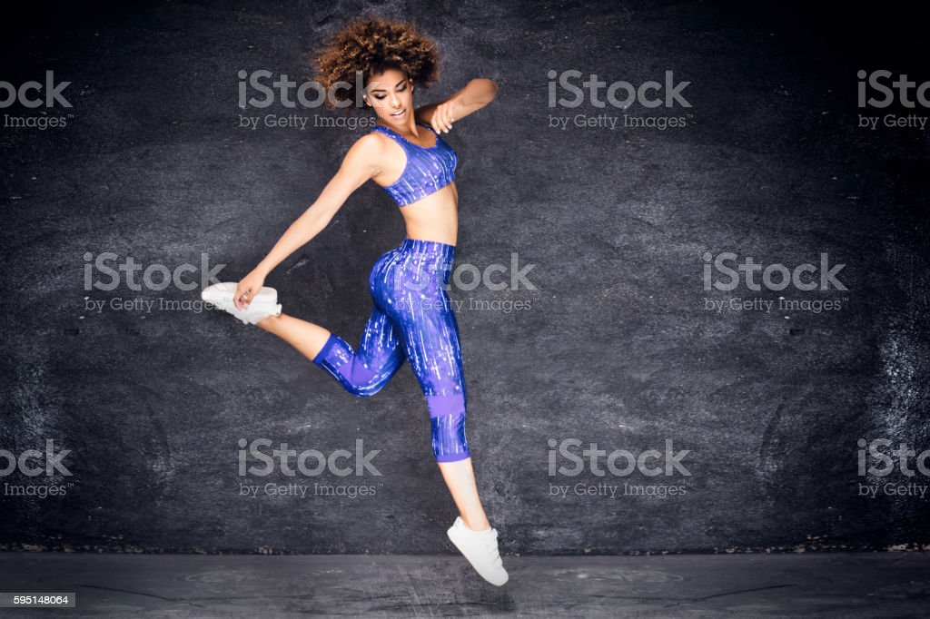 Young african american girl dancing. stock photo