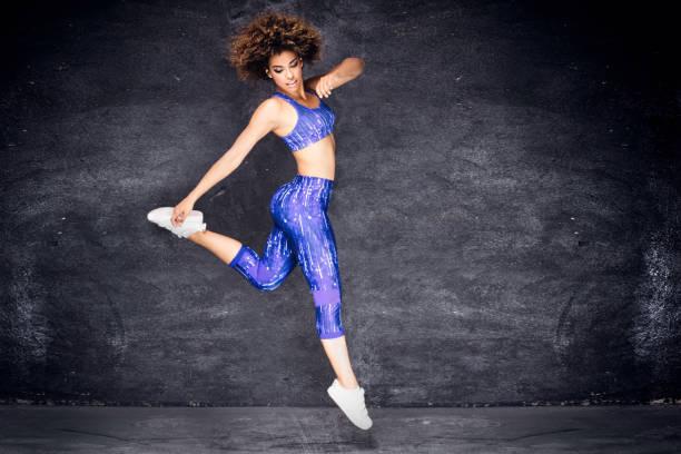 Young african american girl dancing. stock photo