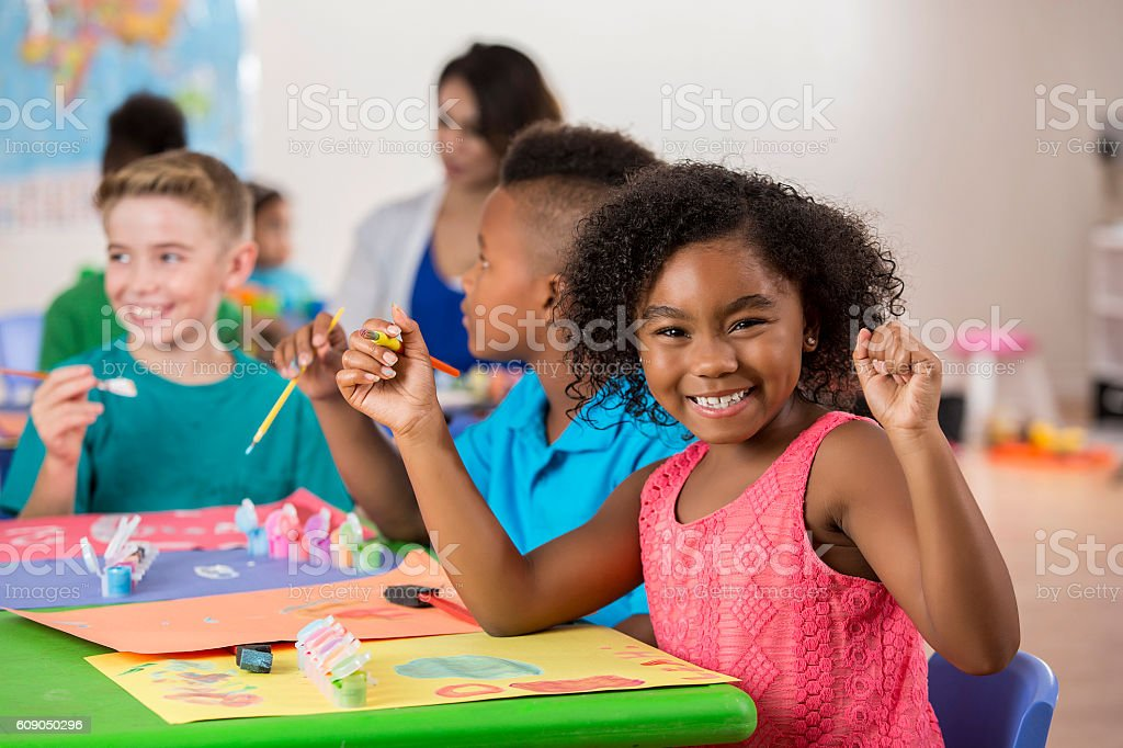 Young African American girl has fun creating artwork - Photo