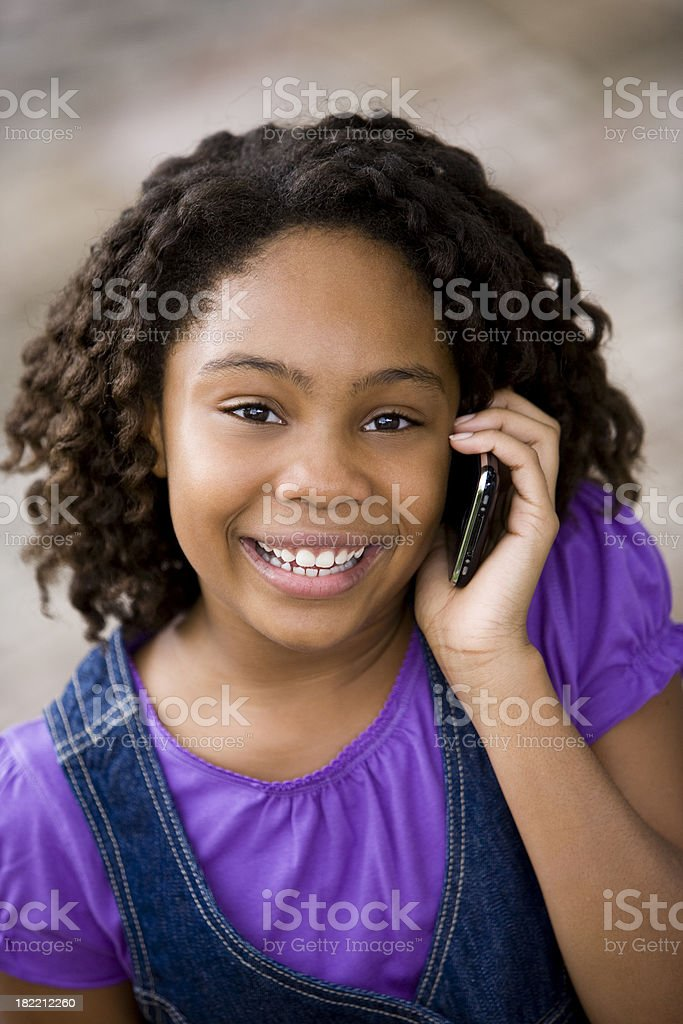 Young African American girl talking on cellphone royalty-free stock photo