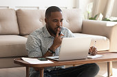istock Young african american guy studying on online courses. 1177334847