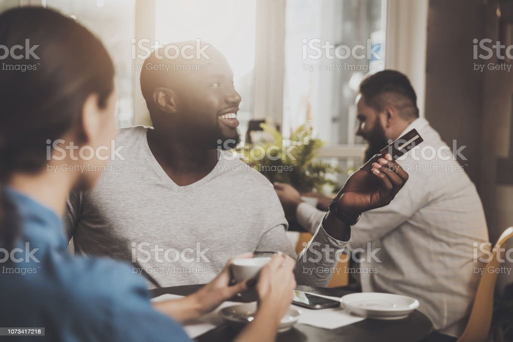 Young African American is calculated credit card stock photo