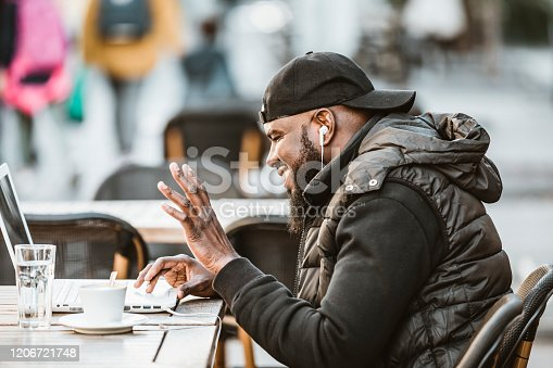 544356862 istock photo Young African American is Enjoying in Coffee in the Outdoor Cafe 1206721748