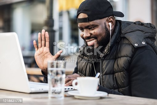 544356862 istock photo Young African American is Enjoying in Coffee in the Outdoor Cafe 1218831776