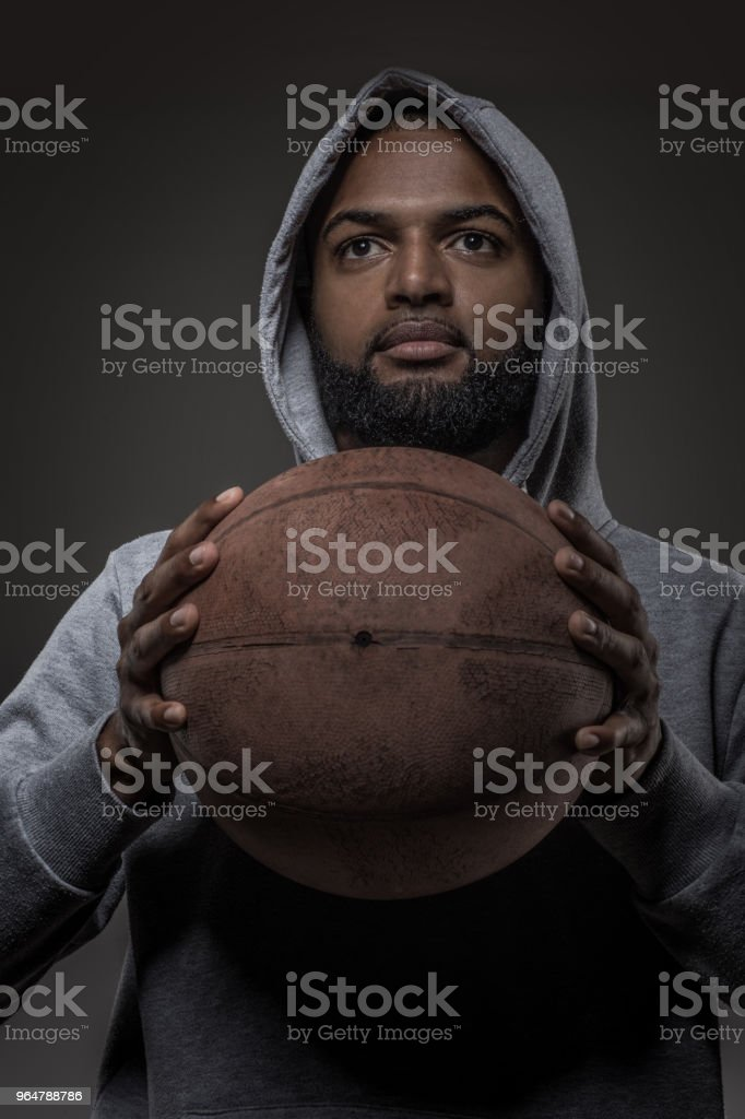 A young african american male basketball player in studio shot royalty-free stock photo