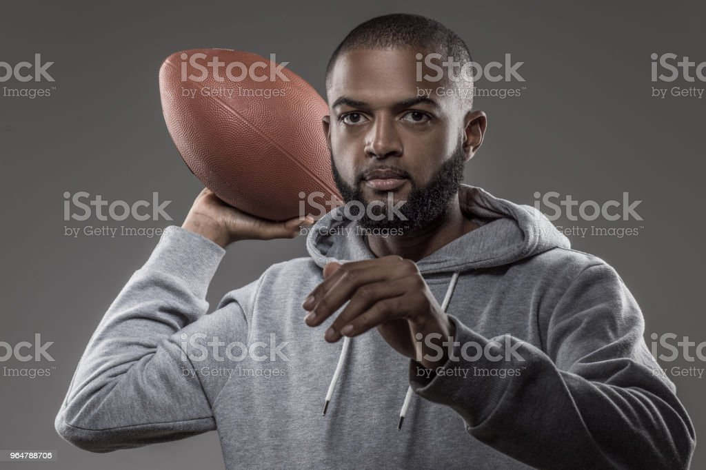 A young african american male flag football quarterback player in studio shot royalty-free stock photo