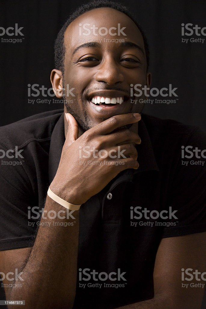 Young African American Male on black background stock photo