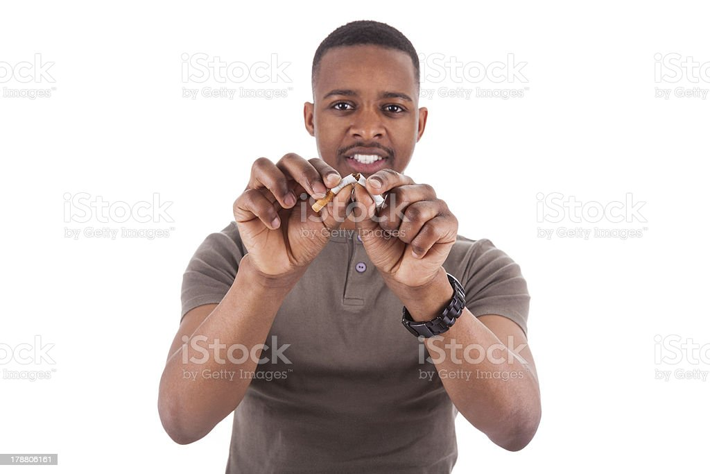 Young african american man breaking a cigarette stock photo