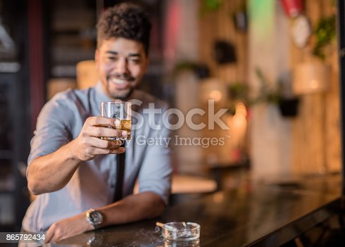 istock Young African American man cheering with whiskey 865792434