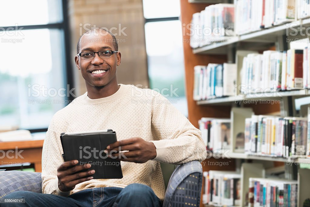 Young African American man in the library stock photo