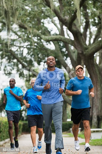 istock Young African American man leading group of runners 531253745