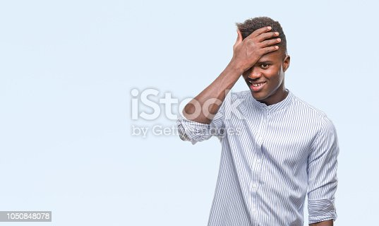 1046559700istockphoto Young african american man over isolated background surprised with hand on head for mistake, remember error. Forgot, bad memory concept. 1050848078