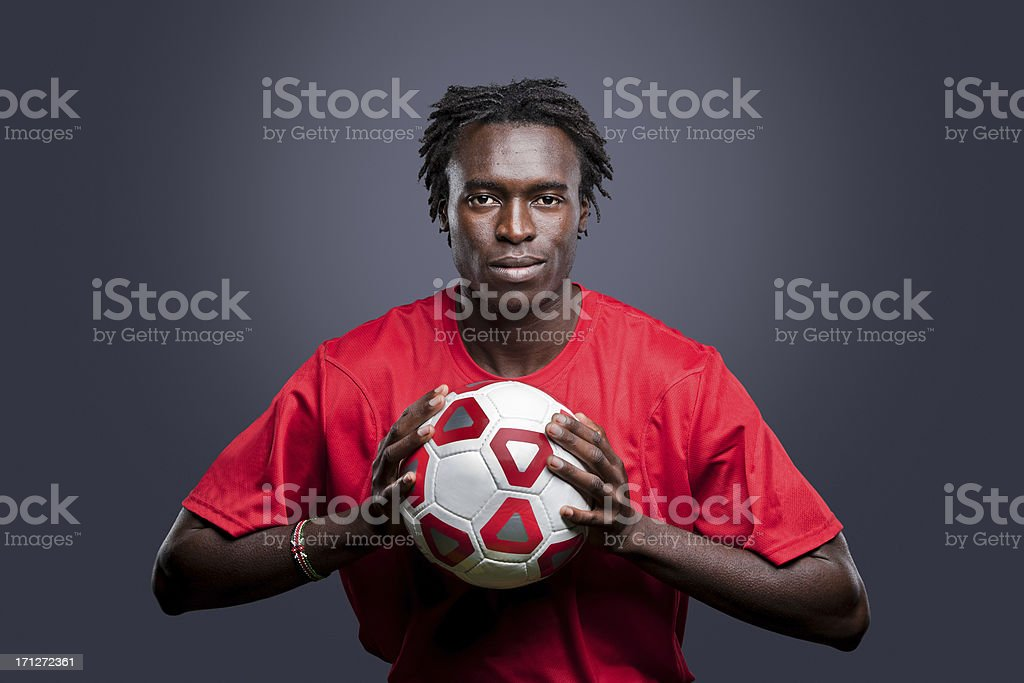 Young African American man soccer player stock photo