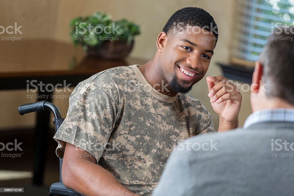 Young African American soldier being assessed by military counselor stock photo