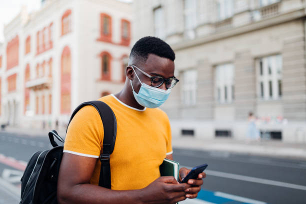 Young African American student using his smart phone stock photo