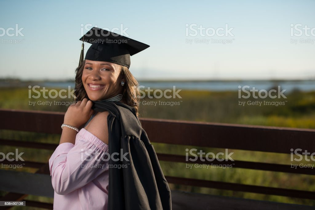 Young African American Teenager In Cap And Gown With Her Instrument ...