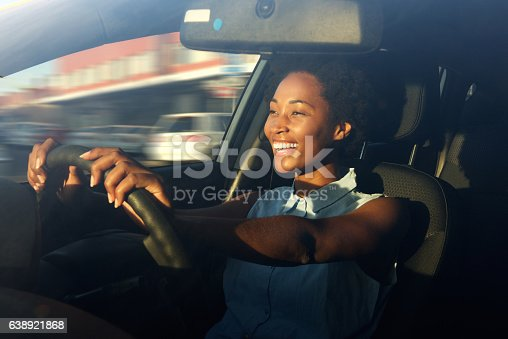 istock Young african american woman driving a car 638921868