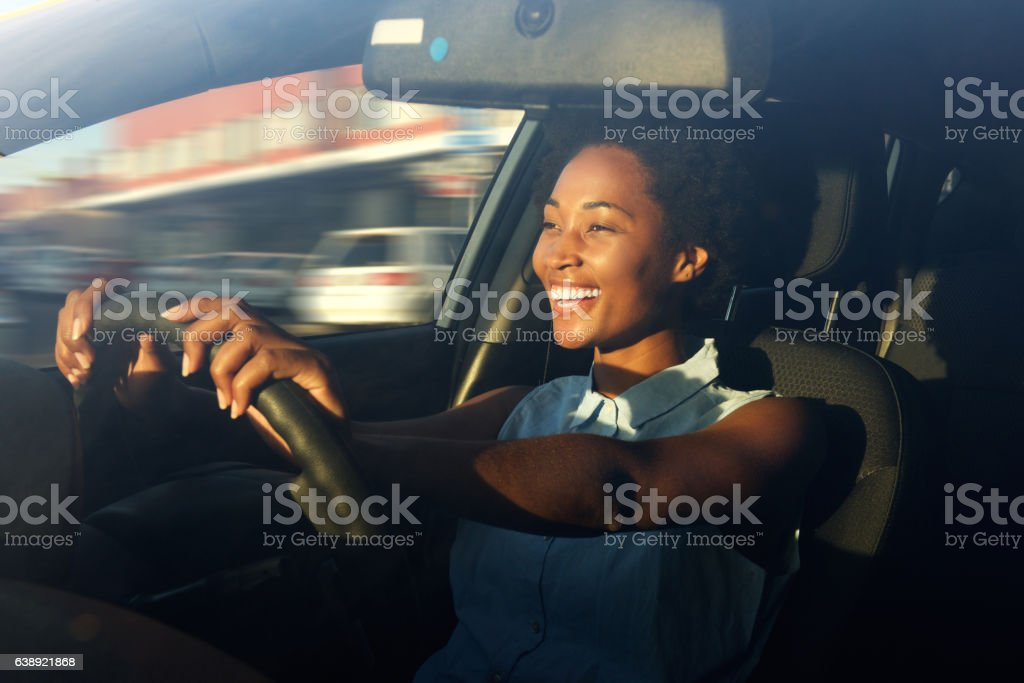 Young african american woman driving a car stock photo