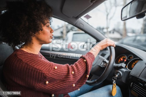 Young African American woman driving the car