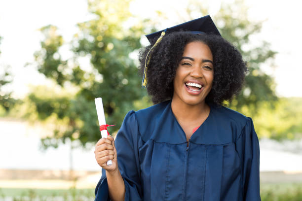 Young African American woman graduating. stock photo