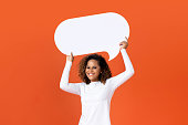 istock Young African American woman holding empty speech bubble 1175303358
