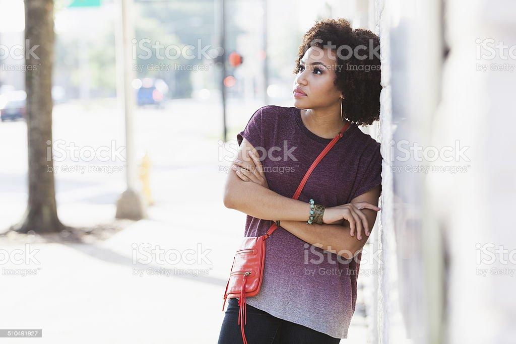 Young African American woman in city stock photo