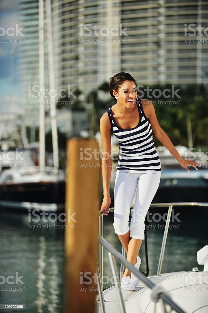 Young African American Woman on Motor Boat Yacht royalty-free stock photo