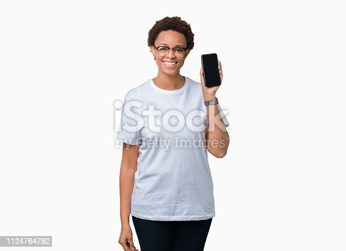 istock Young african american woman showing smartphone screen over isolated background with a happy face standing and smiling with a confident smile showing teeth 1124764792