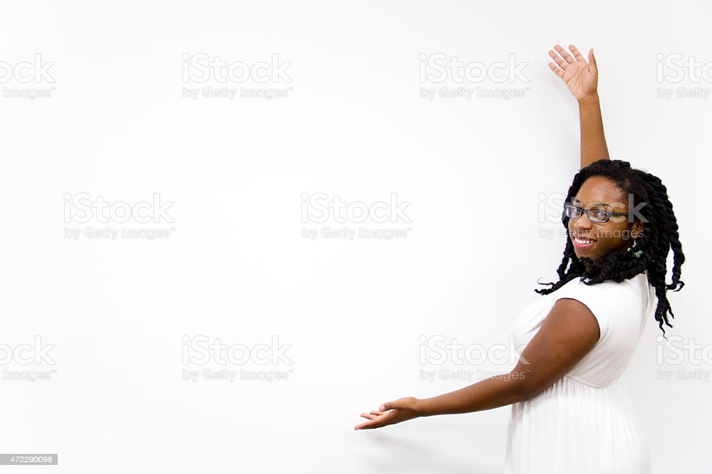 Young African American Woman Showing something on Poster stock photo