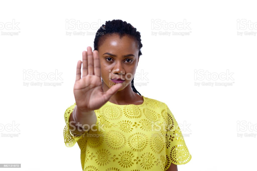 Young African American woman showing stop gesture stock photo