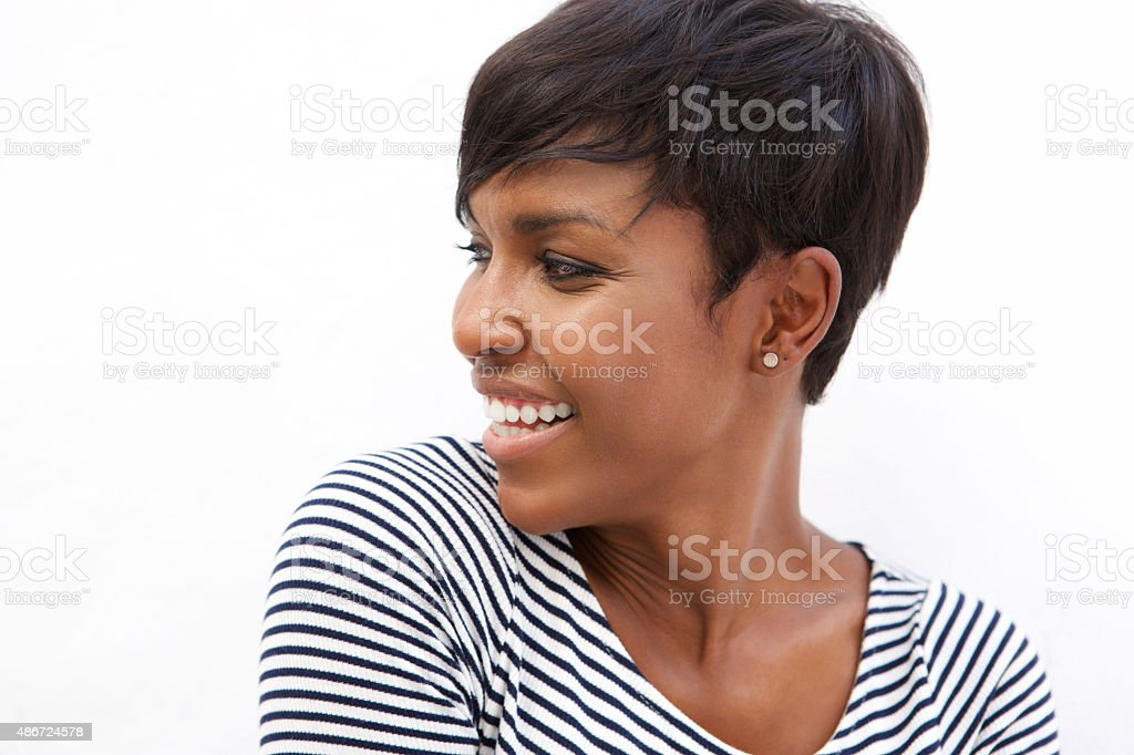 Young african american woman smiling and looking away stock photo