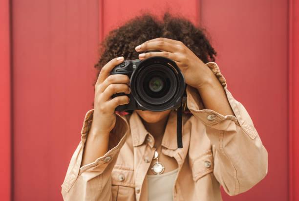 Young african american woman using digital camera on street picture id1002873938?b=1&k=6&m=1002873938&s=612x612&w=0&h=y9scvvjwzns2yrjewdq5x5a9zobjtm8qxloloq rdbq=